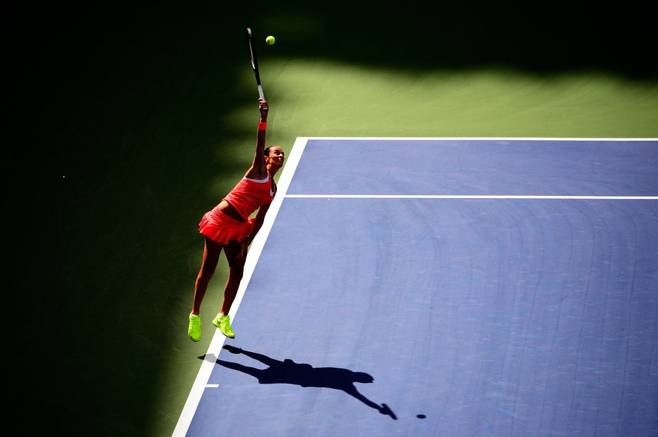 NEW YORK, NY - SEPTEMBER 11: Roberta Vinci of Italy serves to Serena Williams of the United States during their Women's Singles Semifinals match on Day Twelve of the 2015 US Open at the USTA Billie Jean King National Tennis Center on September 11, 2015 in the Flushing neighborhood of the Queens borough of New York City. (Photo by Alex Goodlett/Getty Images)